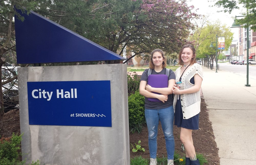 Cora and Molly at City Hall in Bloomington, before Molly's presentation to the Bloomington Commission on Sustainability. The Commission was very responsive to her proposal to thread youth-led climate recovery work into Bloomington's already-existing sustainability initiatives and planning.