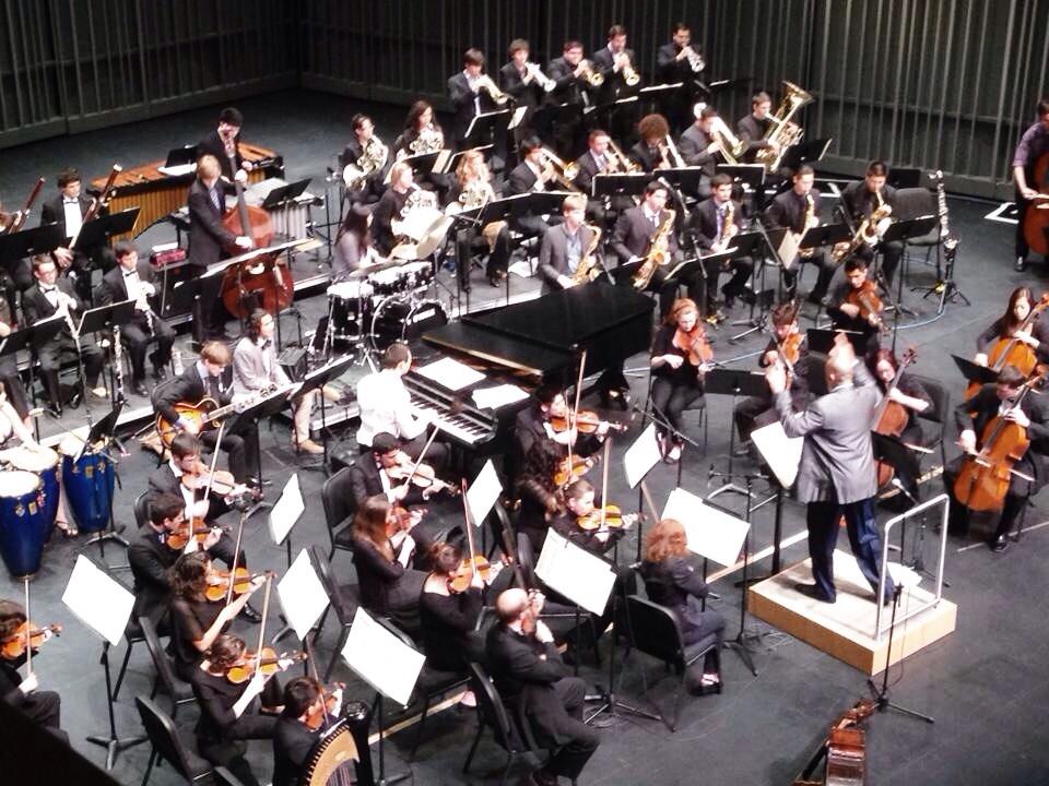 jon clayton conducting the orchestra. i'm on the bottom left.
