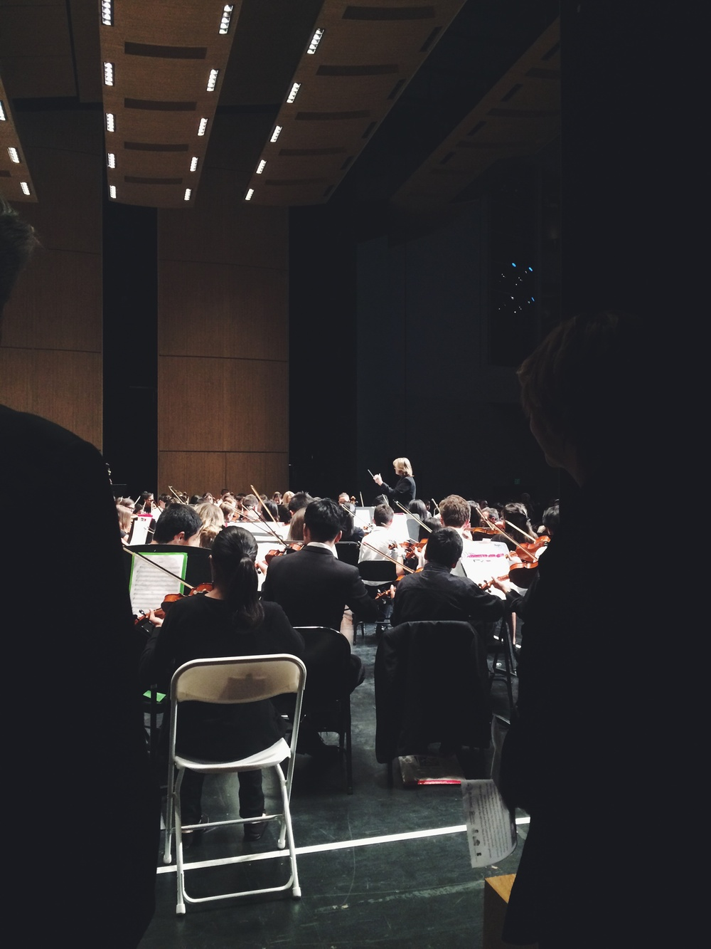 this is one of my bosses conducting the middle school group. our kids were the best behaved and most in tune. proud mama moment!