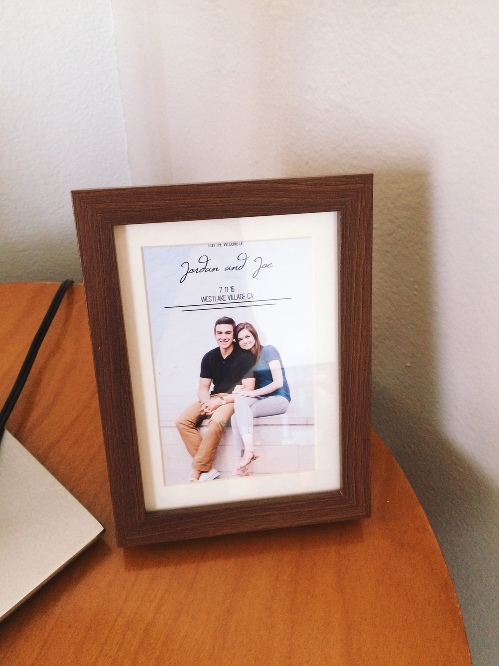 "our save the date fit almost perfectly in this frame. so i said ""good enough for me"" and now the two of us cuties are represented here."