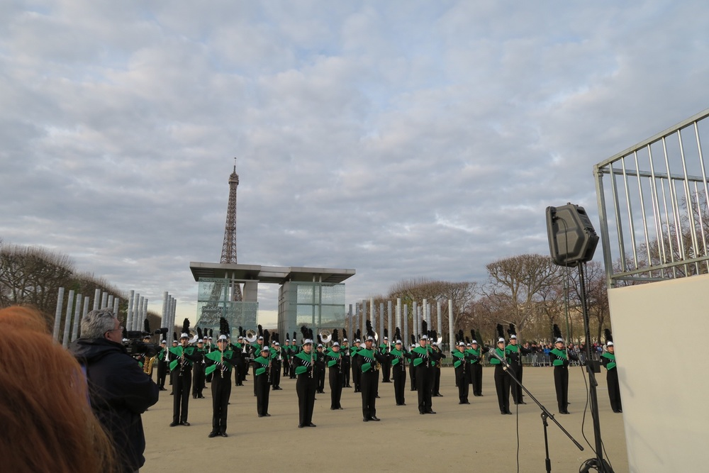 ^ the marching band performing in front of the eiffel tower