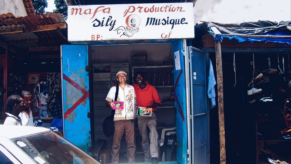 Frank Gossner and Mr. Mafa at Mr. Mafa's record store in Conakry, Guinea  |  Exclusive title design by Kunel Gaur of Animal.