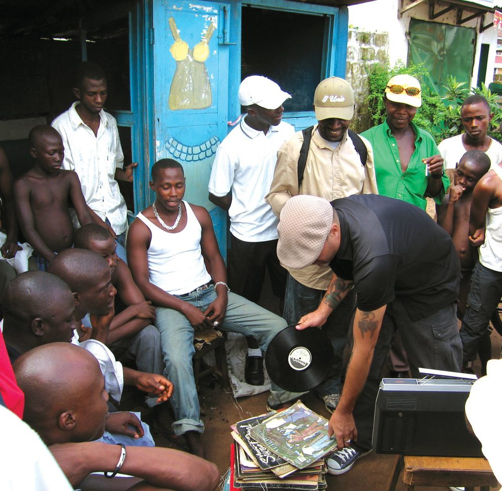 Frank in Freetown in Sierre Leone playing records with the locals.