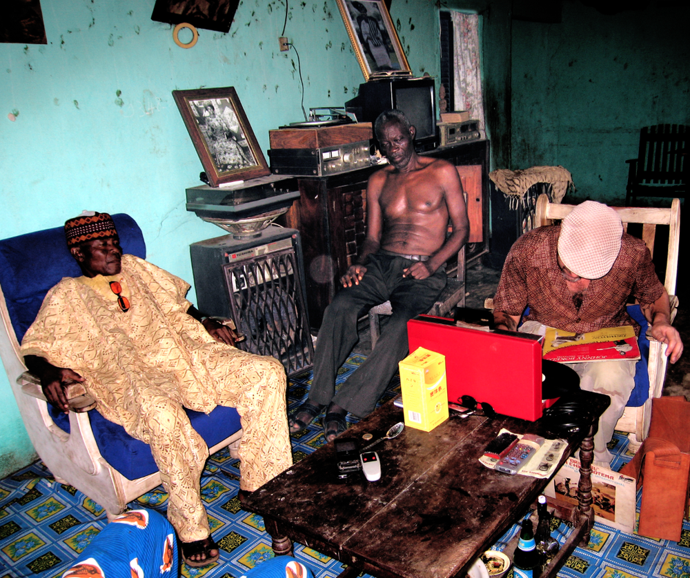 Frank at a private home in Porto Novo, Benin digging through a record collection.