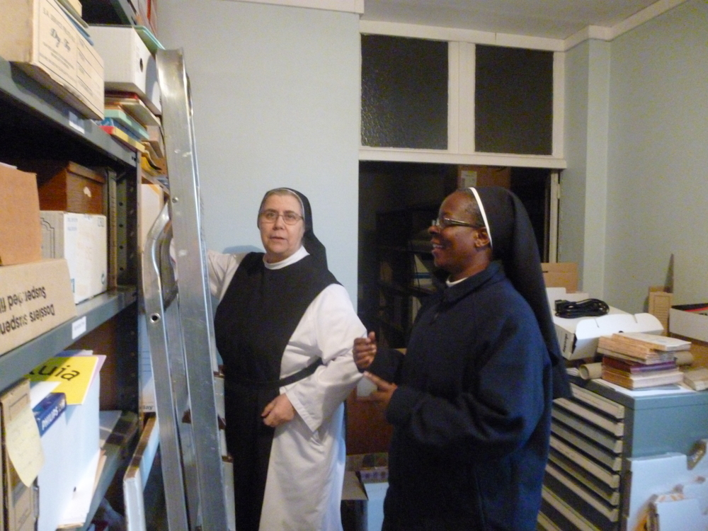 Two of the sisters in the Archives of the Order.