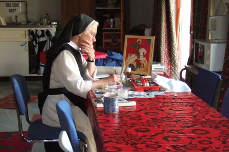 Sr Stella writing an Icon.