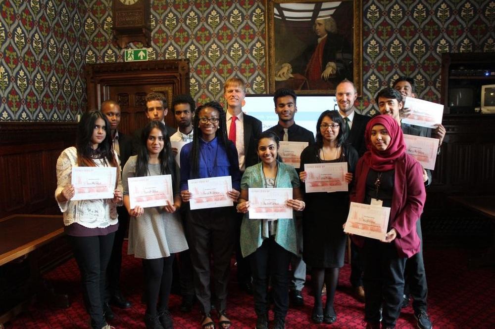 Students receiving their Politics School certificates