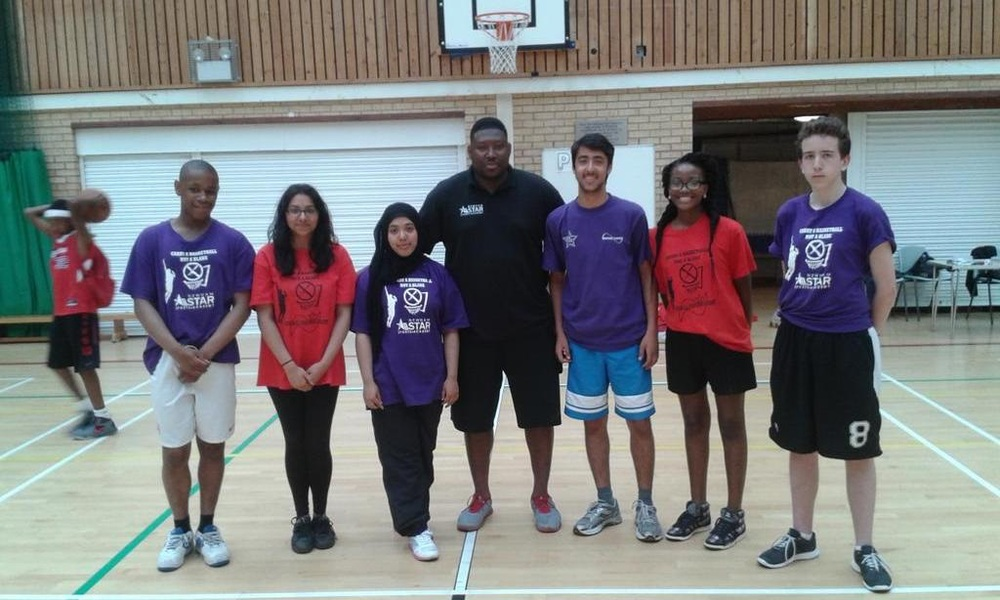 Students working with Coach Chris at Newham All Star Sports Academy
