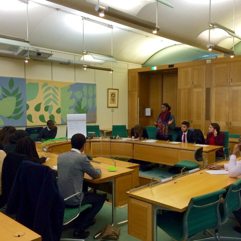 Politics School students learn how to debate with award winning debater Lewis Iwu from Debate Mate