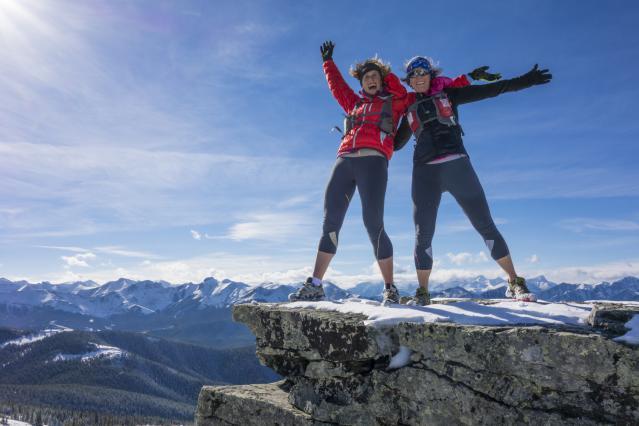 happy-women-smiling-hiking-on-summit.jpg