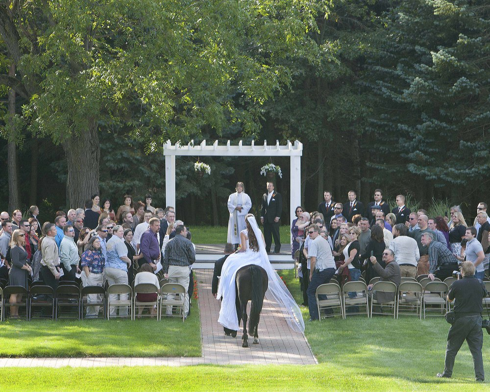 This bride strolls down the cobblestone isle on horseback. Since then we have expanded the pergola.