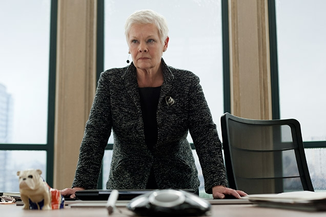 Judy Dench as M in Skyfall, with the AirPad at her desk