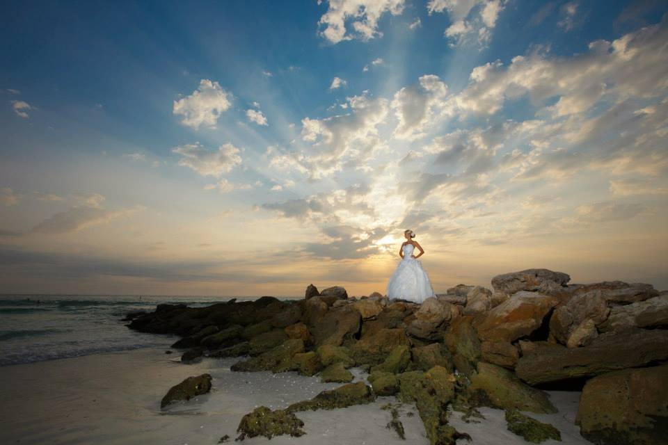 Bride on the rocks at sunset.jpg