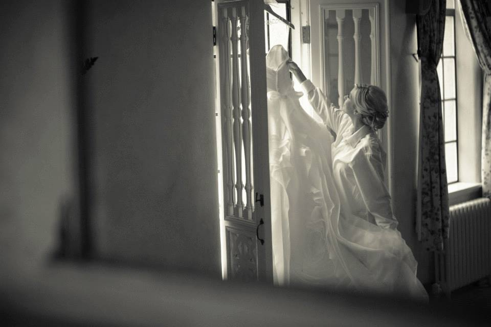 bride hanging dress in door bw.jpg
