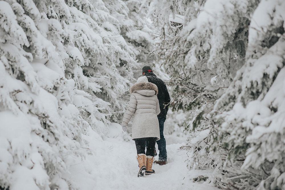 couple-walking-vermont-winter-engagement-session-killington-peak-idena-photographer.jpg