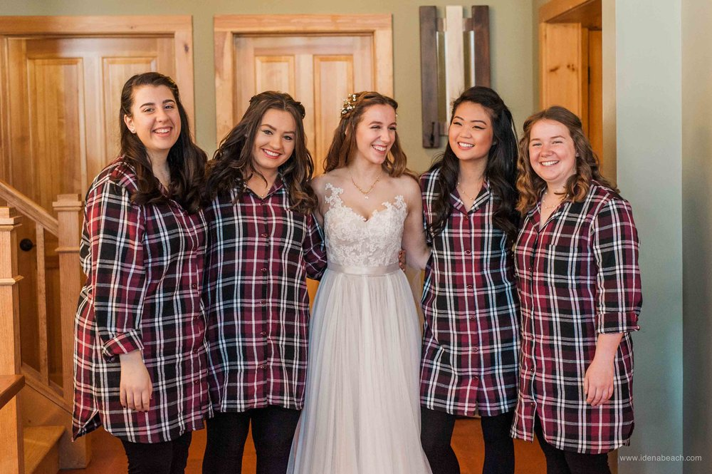 The bridesmaids all wore coordinating burgundy flannel shirts during getting ready