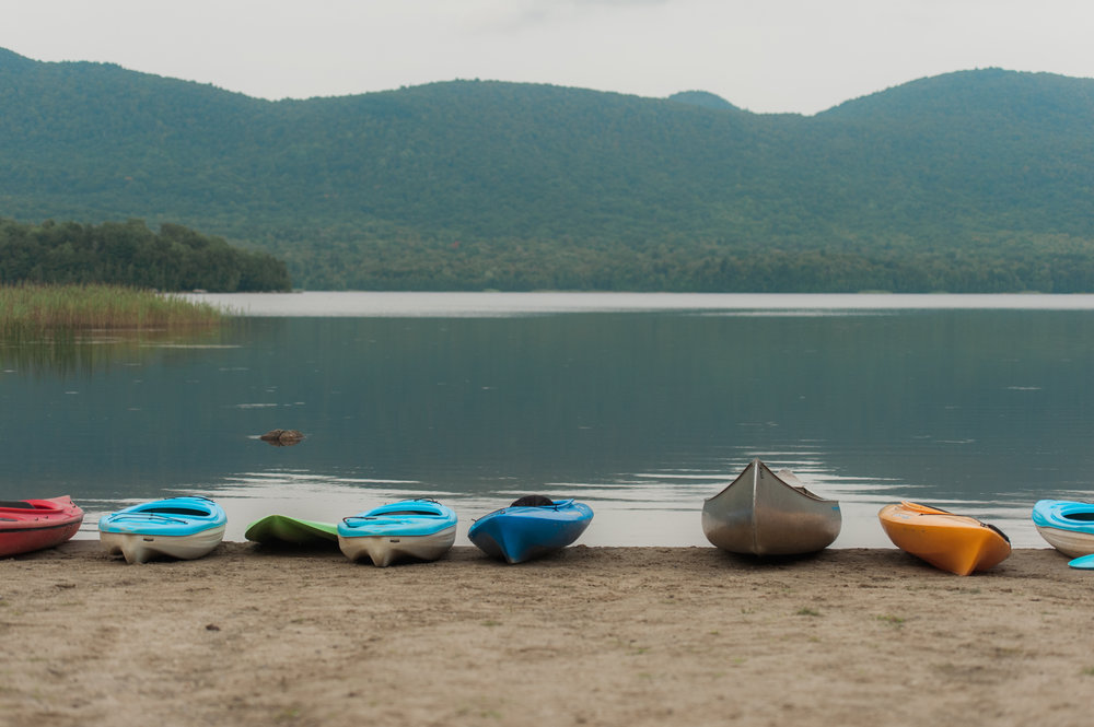 Kayaks on the beach by The Pond Pavilion at Mountain Top Inn and Resort -Idena Beach-Vermont -Wedding -Photographer