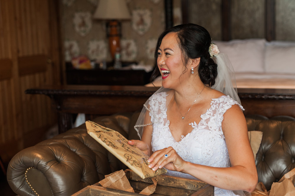 Bride receiving gift from groom
