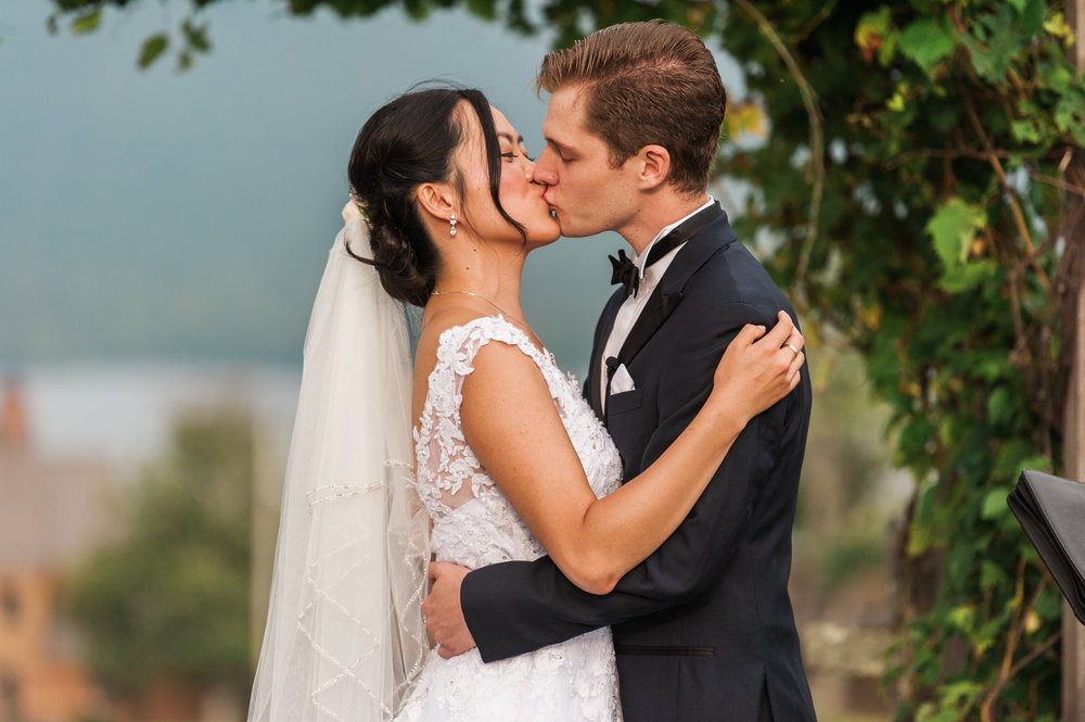 bride and groom kiss after the ceremony