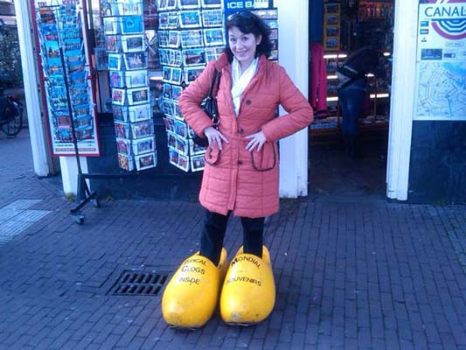 Oh, THIS picture is going on our refrigerator, pronto. Vickie wearing clogs in Amsterdam. Love it.