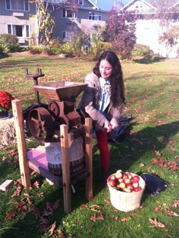 Liz snapped this photo of Steph learning to press apple cider at  Lake Morey Resort . That concentration is admirable.