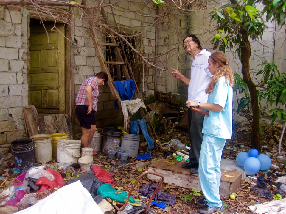 Dr. Montero of the Luchadores del Norte Clinic and IPSL Advocacy Research student Laura, visit the home of an elderly community member who was ill with Chikungunya, a mosquito borne illness. Dr. Montero and Laura investigate the patient's backyard for potential mosquito breeding areas such as the buckets of standing water.
