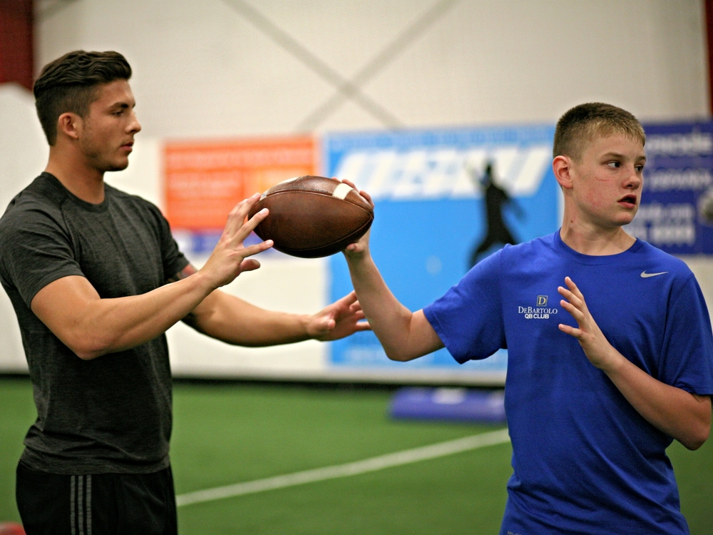 QB Daxx Garman works with Hayden Conrad. 2016 OKC Spring Break QB Training