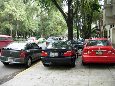 Not one but two cars parked on the sidewalk, Mexico City