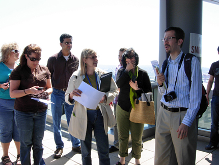 Melanie Davis, center in the jacket, at the Justice Center Green Roof during the Seattle Green Roof Tour