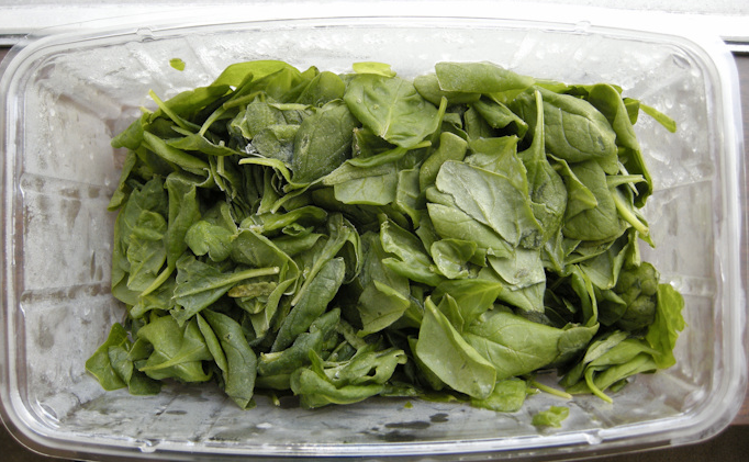 First compost receptacle = spinach box. A little too funky to rinse and reuse (image via feedyourskull.com).