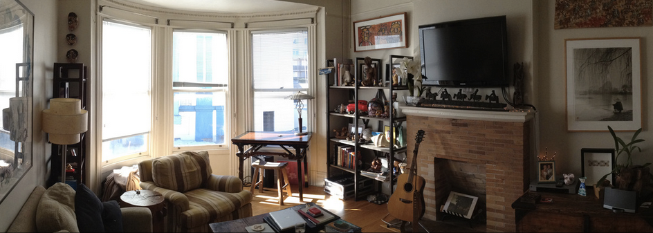 Before: The space feels heavy and dark, cluttered by large furniture and overstuffed shelves.