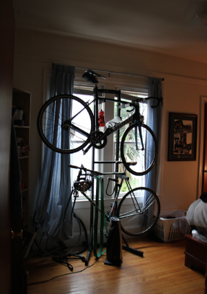 Before: Due to a cluttered living room, C was forced to store his bikes in his bedroom, blocking his only source of natural light and creating a feeling of chaos upon entering his bedroom.