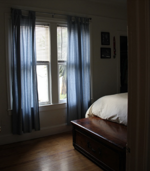 After:  The subtly lit bedroom feels exponentially more restful and serene after removing the bikes and their racks.