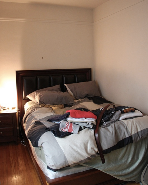 Before:  The bed is pushed to the corner to make room for the wide swing of the closet door.