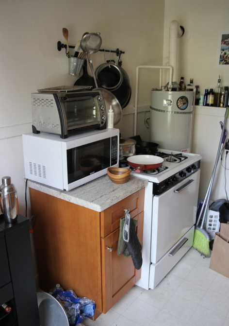 Before:  The little prep space there was next to stove is dominated by rarely used appliances.
