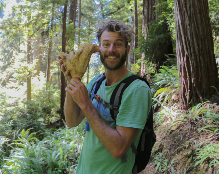 This is a gratuitous photo of my handsome husband with a mushroom the size of his head.