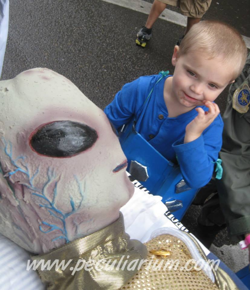 Angleberk makes friends at the UFO festival in McMinnville, Oregon.