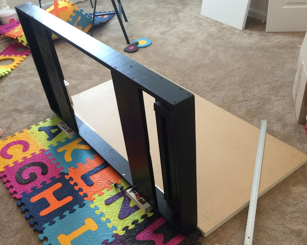 Centering the desk frame with the table top.