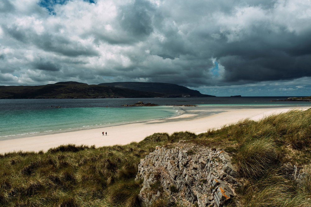A remote, white sand beach on Faraid Head with views over Cape Wrath.