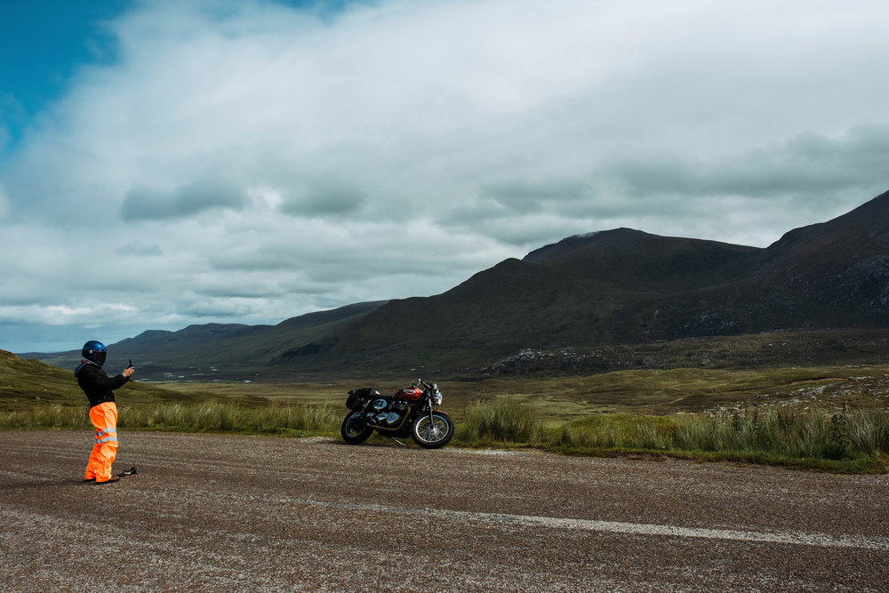 A motorcyclist photographs the view near Cape Wrath. I like to pretend this is one half of Daft Punk.
