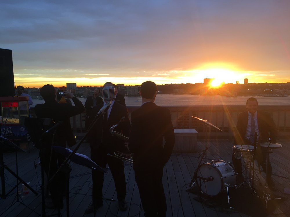 Beautiful sunset over the Hudson river with Peter and the Master Keys performing jazz and blues for a corporate event at the Starrett Le-High building in Chelsea, Manhattan.