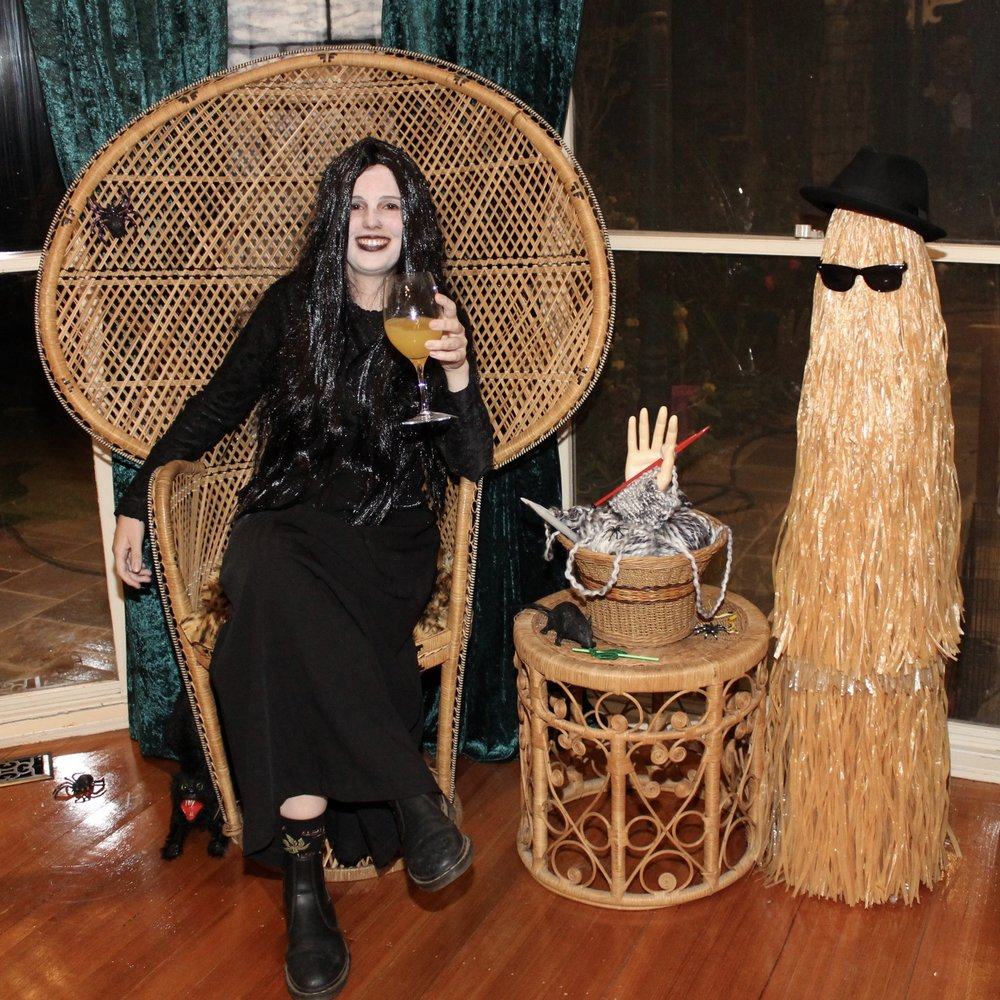 Morticia Addams with Cousin It & Thing