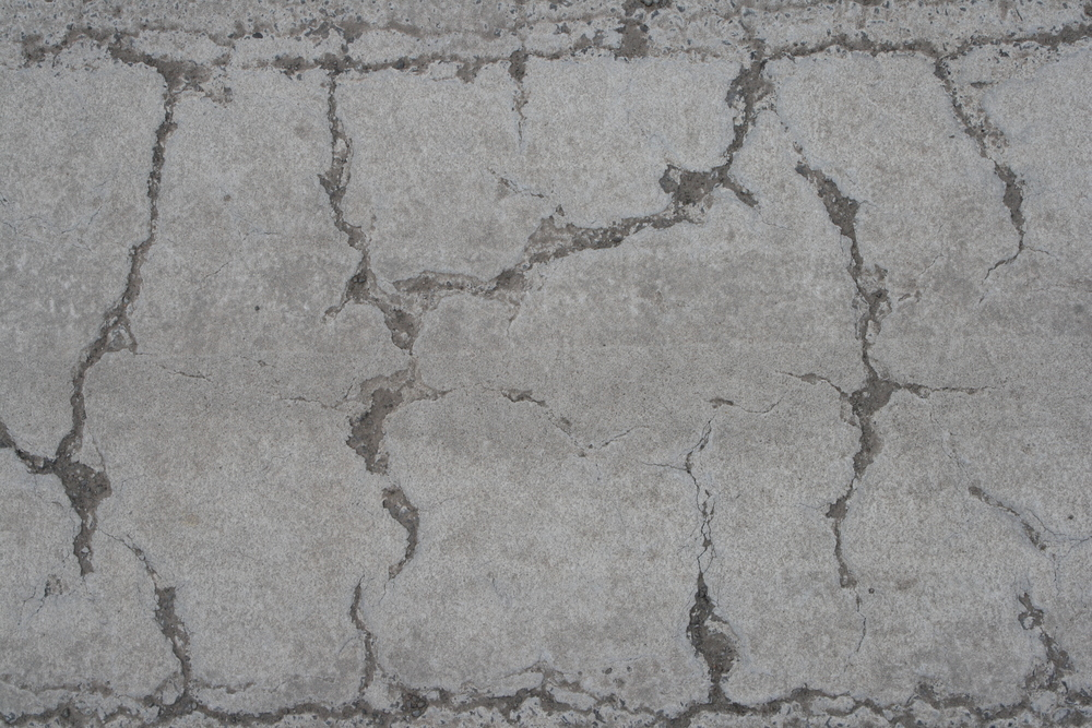 Concrete cracks from heat and moisture.