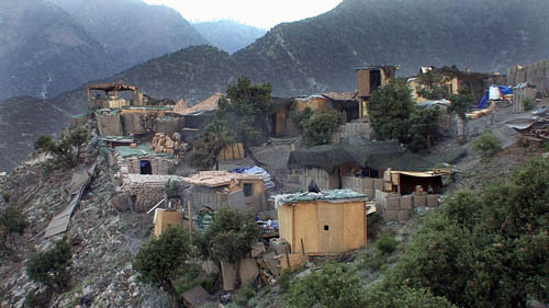 Image courtesy of Huffington Post and Outpost Films (Image copyright). Photo is of Outpost Restrepo, Korengal Valley, Kunar Province, Afghanistan; taken as a film still from the documentary Restrepo, by Tim Heatherington and Sebastian Junger.