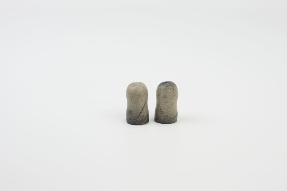 earplugs - carved from a fossilized inner ear bone of a whale