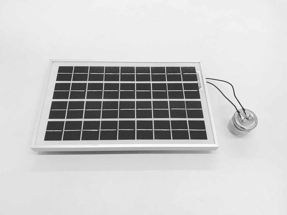 get better - 5 watt solar panel with jar of mud from the dead sea