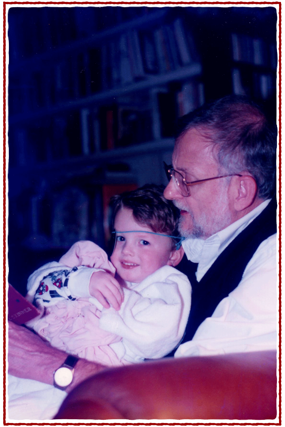 Christmas Eve 1996: my dad reads the story to us with my son, Henry (in his pirate phase), in his lap.