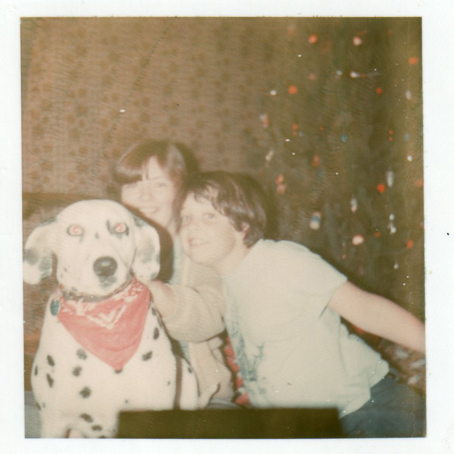 Betsy & Jason, with our beloved but crazy dalmatian, Robin