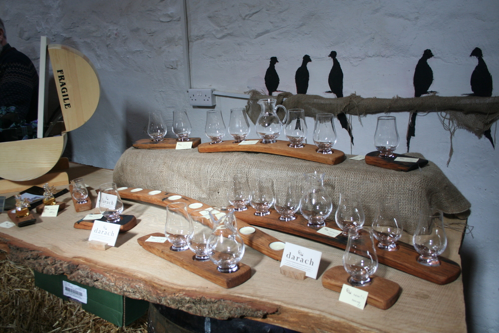 Darach Gifts displaying their whisky barrel candle (or glass!) holders.