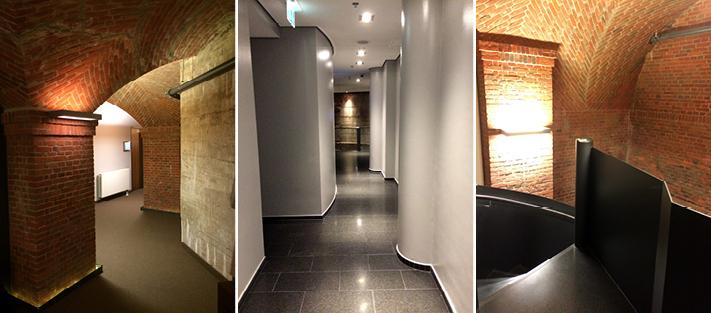 Die Durchgänge wurden in den unteren Etagen durch die Kombination der Baustoffe, der Formen und der Farben spannend gestaltet.
